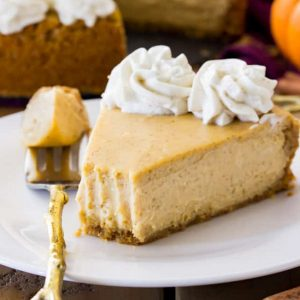 pumpkin cheesecake slice on white plate