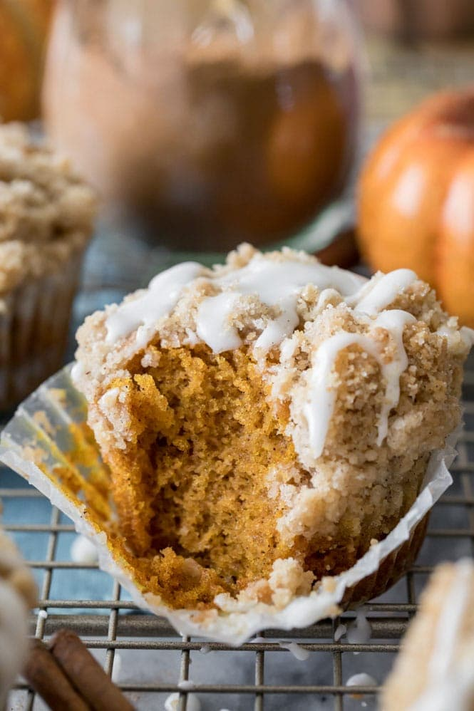 Muffin with bite out of it: Showing the soft fluffy inside of pumpkin muffin