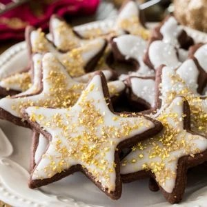 Chocolate sugar cookies in star shape with white icing