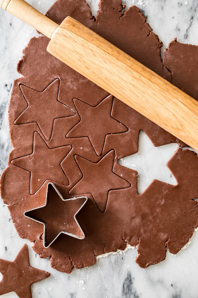 How to make Chocolate Sugar Cookies: Rolling out and cutting dough with cutter