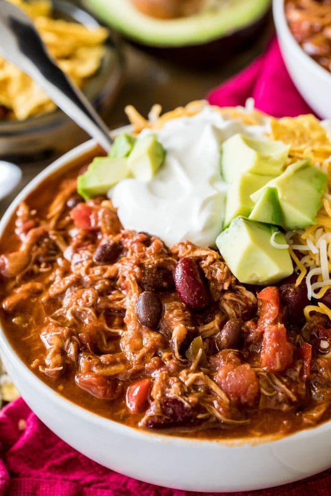 Close up of bowl of Turkey Chili topped with sour cream and avocado