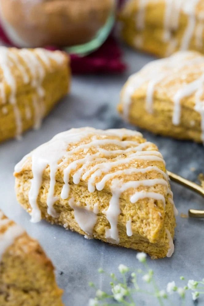 pumpkin scone drizzled with vanilla glaze