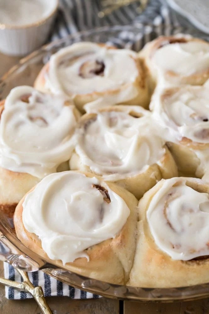 fluffy golden cinnamon rolls with cream cheese frosting