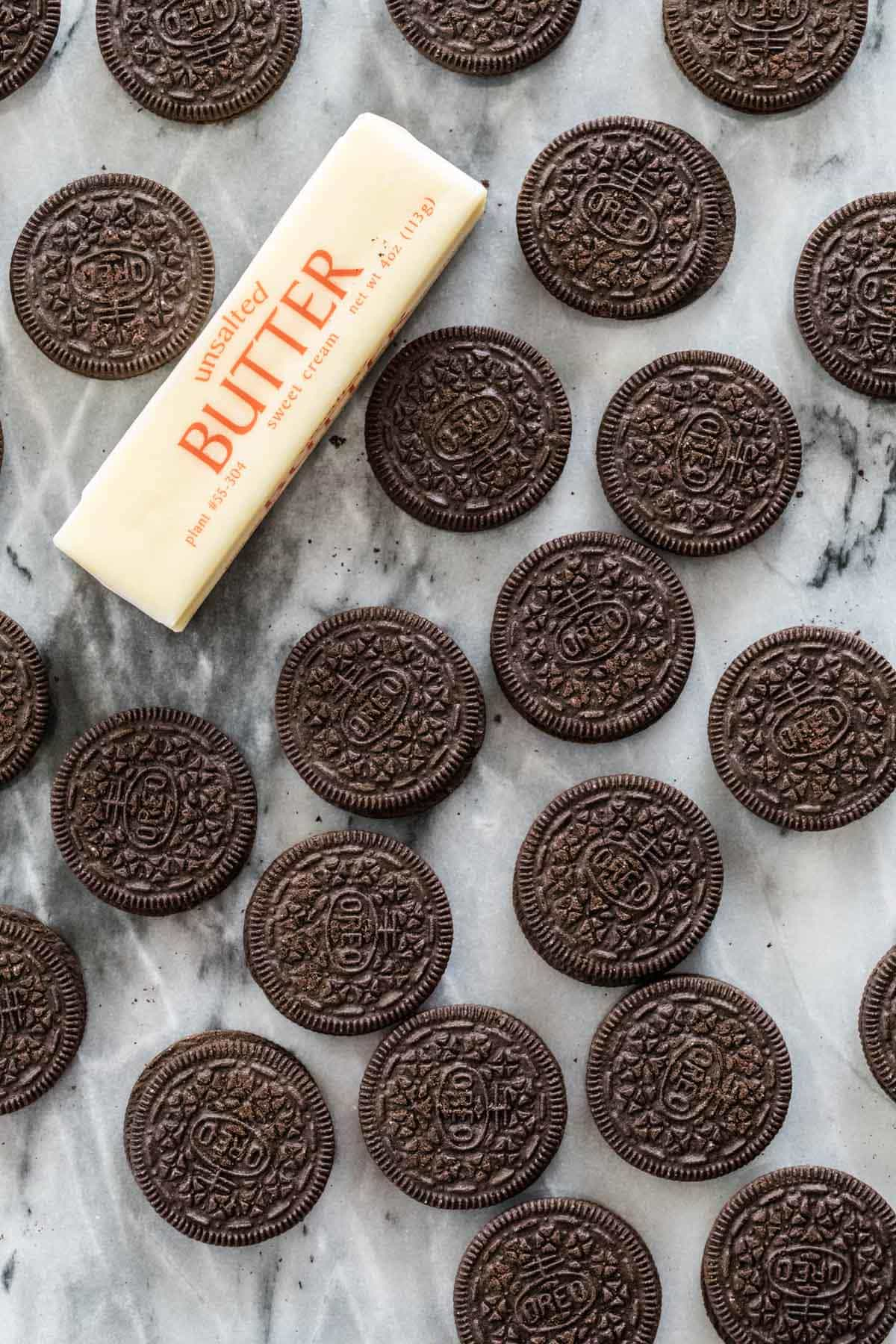 oreo cookies and stick of butter on marble