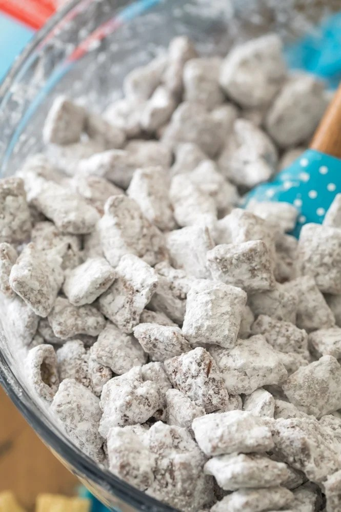 Making Puppy Chow (or Muddy Buddy), coating cereal with powdered sugar