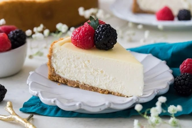 Slice of creamy cheesecake on white plate