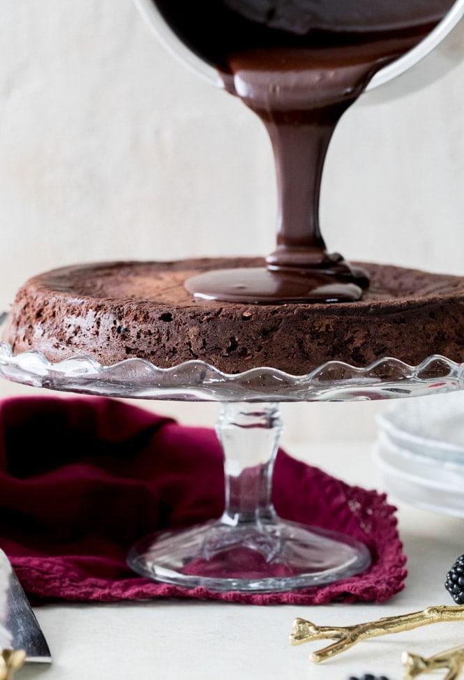 Pouring Ganache over cake