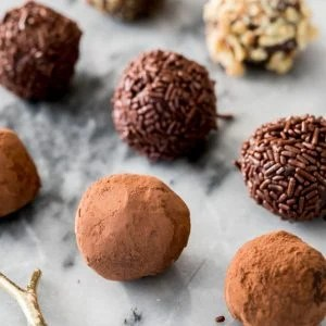 Chocolate truffles on marble surface