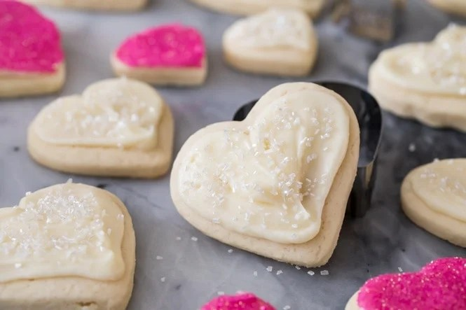 Soft heart shaped cream cheese sugar cookie on cookie cutter
