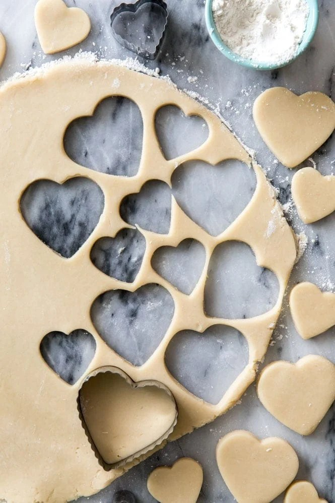 cream cheese sugar cookie dough rolled out and cut into hearts