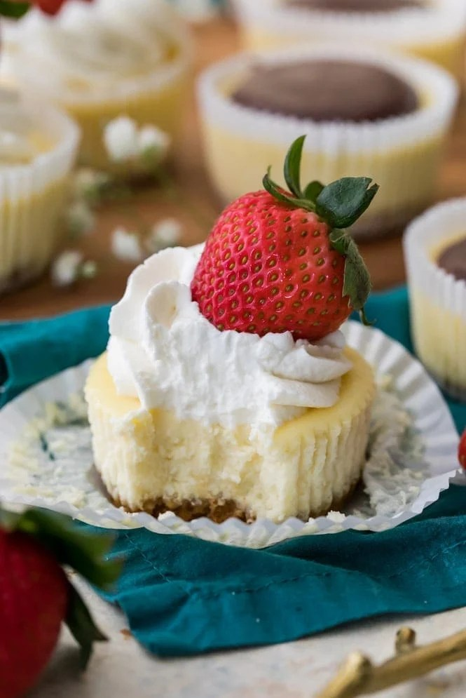 Mini cheesecake with a bite out of it (showing creamy center)
