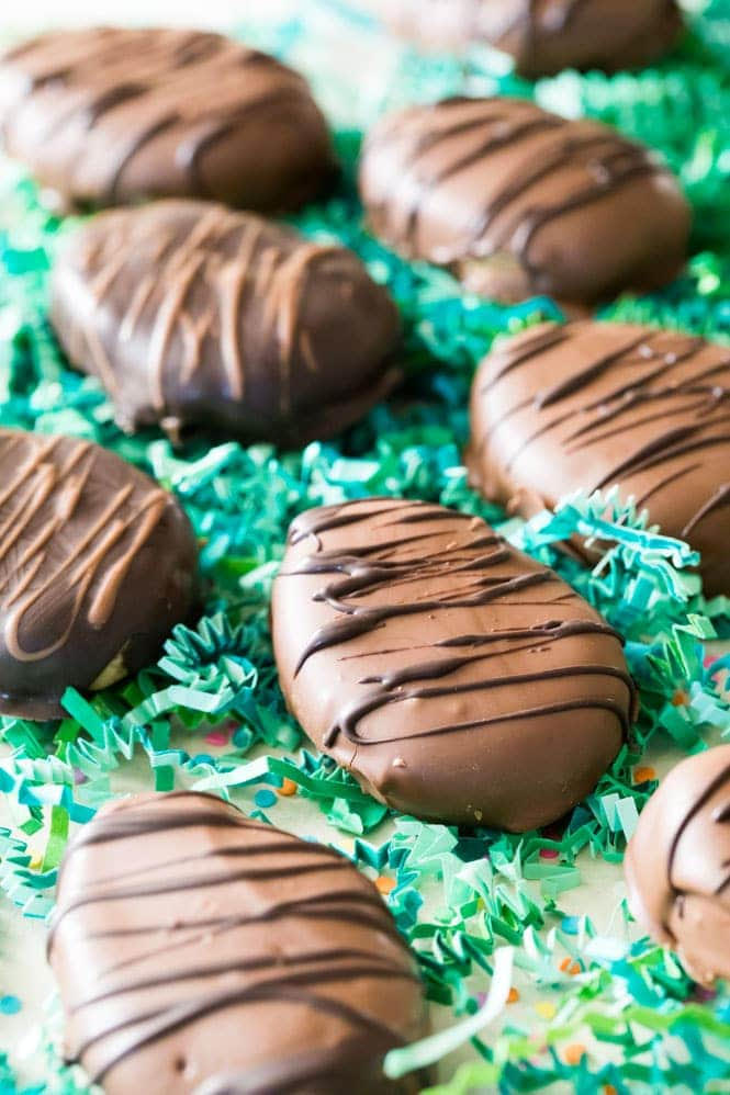 Chocolate covered Peanut Butter Eggs on green Easter grass