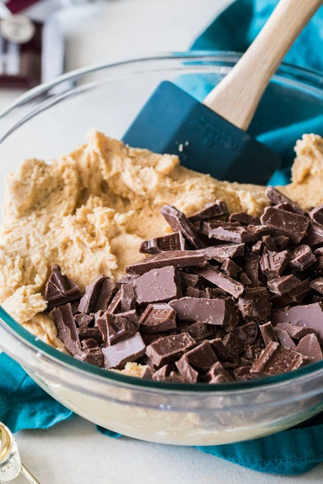 Cookie Dough in bowl - stirring chocolate pieces into peanut butter dough