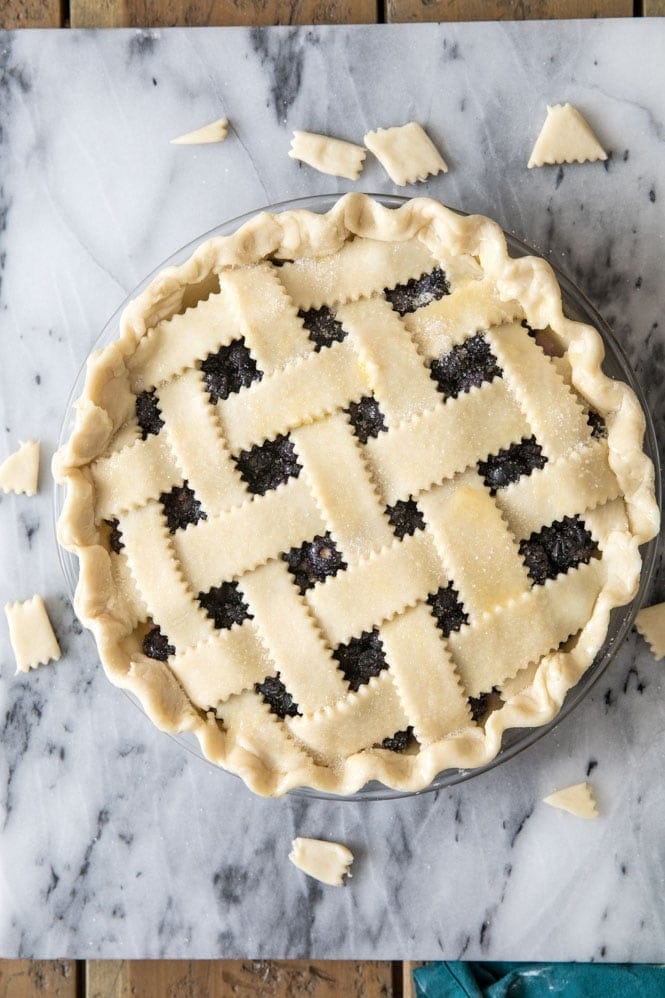 Lattice pie topping brushed with egg wash about to be baked