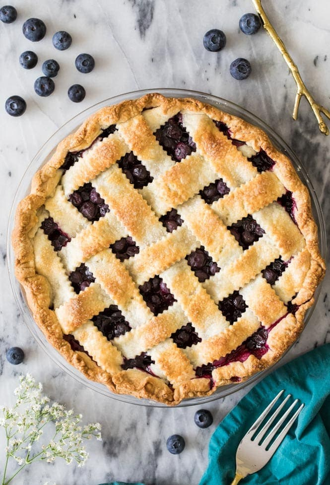 Freshly baked blueberry pie cooling