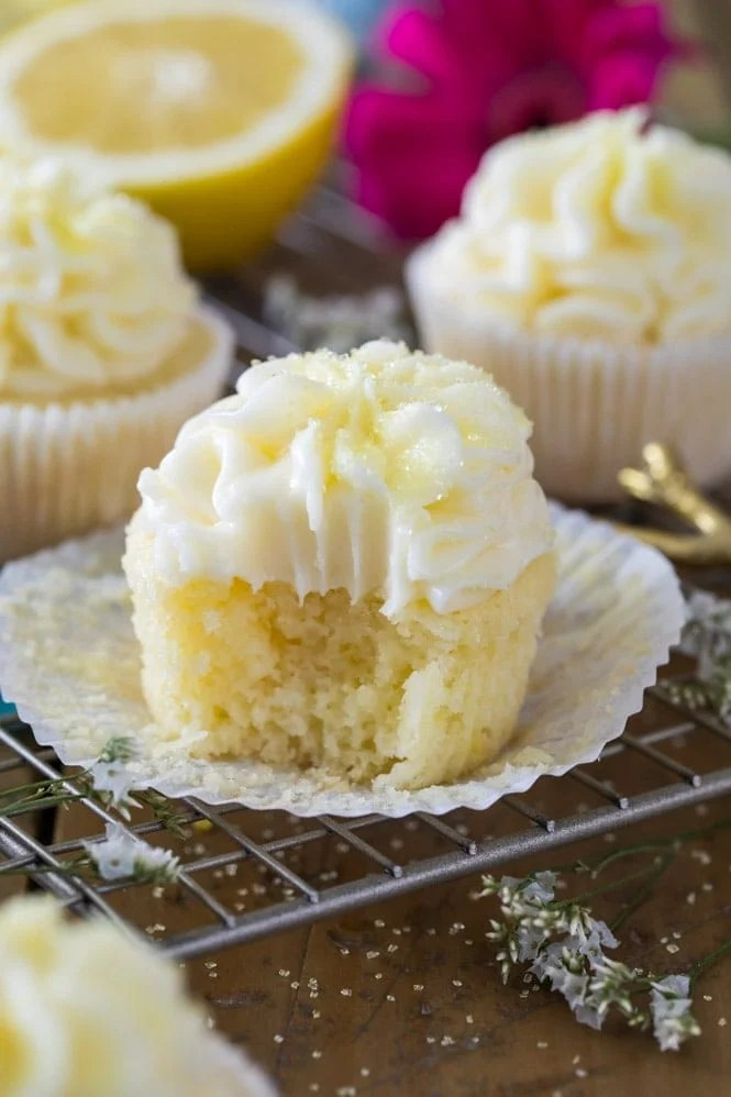 Bite shot of lemon cupcake: showing soft fluffy interior
