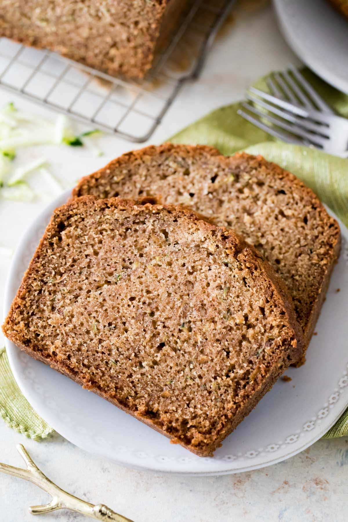 two slices of zucchini bread on white plate