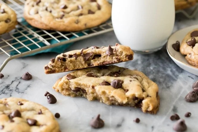 Big chocolate chip cookie broken in half with halves stacked on top of each other