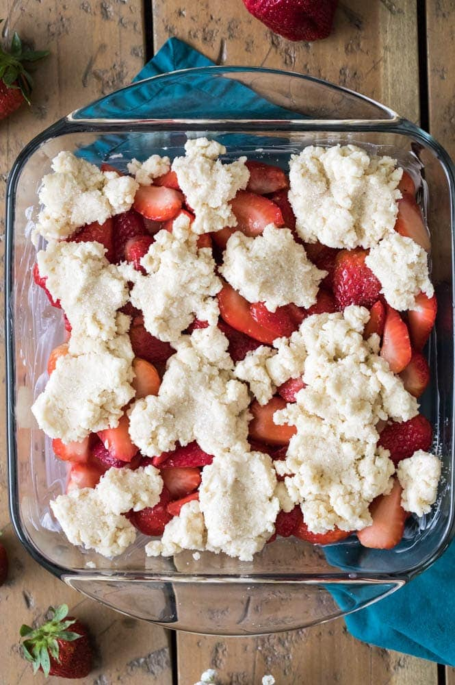 Strawberry cobbler in glass dish before going in oven
