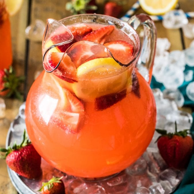 pitcher of strawberry lemonade on ice