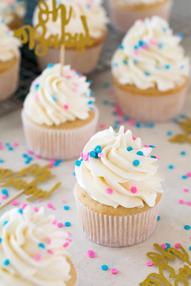 Gender reveal cupcakes: yellow cupcakes with swiss meringue buttercream frosting and blue and pink sprinkles