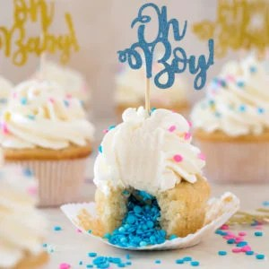 """Cupcake broken open to reveal insides topped with frosting and """"oh Boy!"""" decoration"""