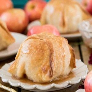 Apple dumpling on white plate