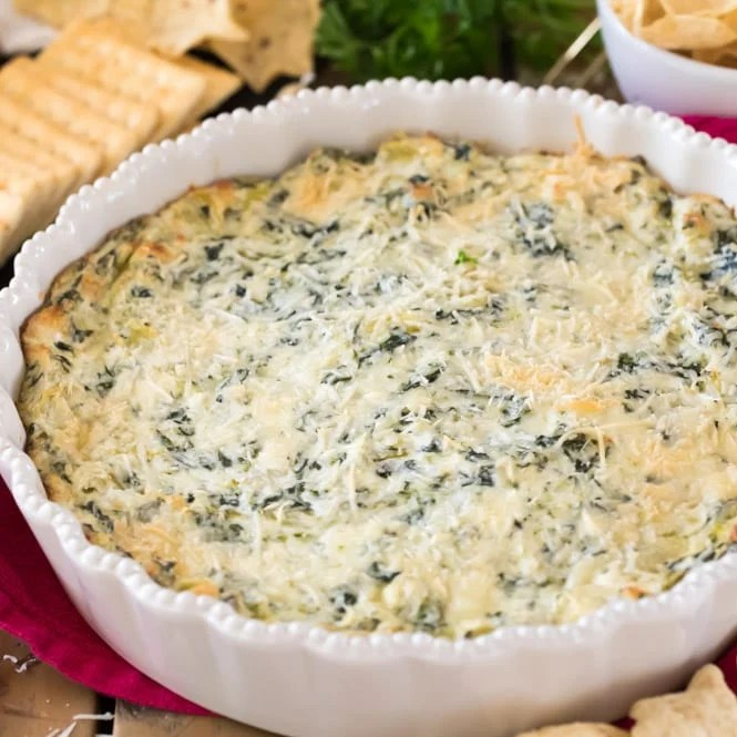 artichoke dip in white pie plate