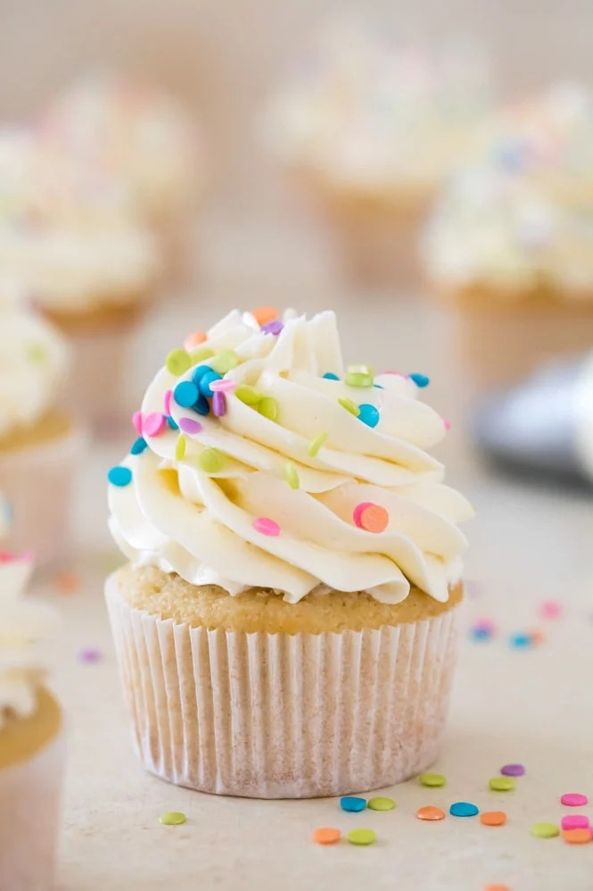 Vanilla cupcake topped with Swiss Meringue Buttercream frosting and sprinkles