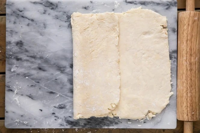 Folding over puff pastry dough like a letter