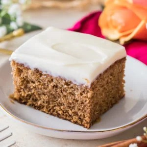 Piece of spice cake on white plate