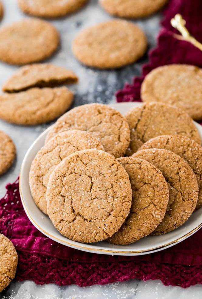 Gingersnap cookies on a white plate on a red napkin