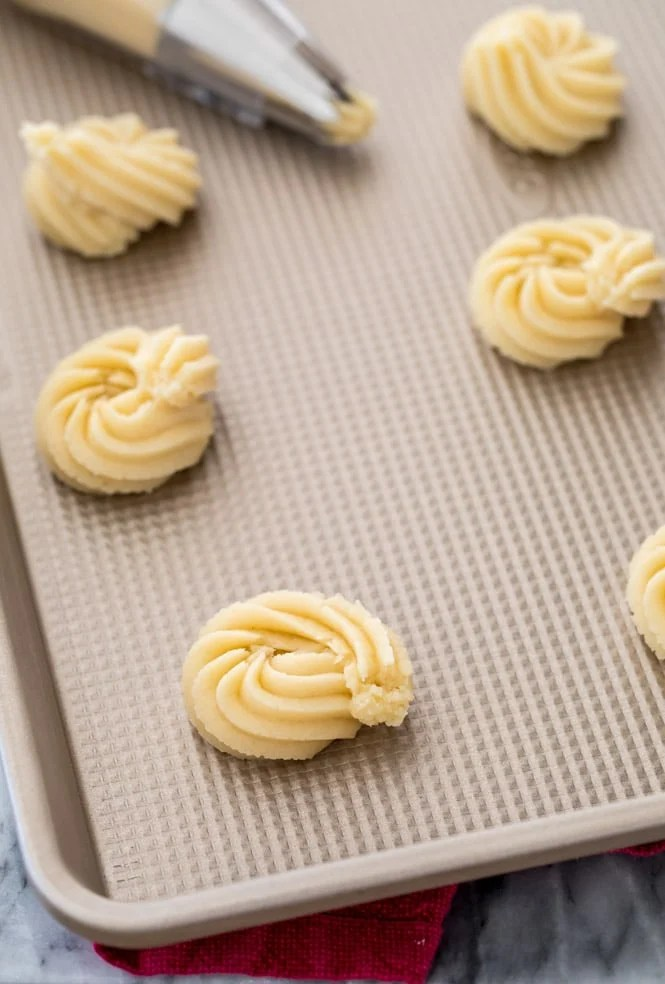Butter cookies piped onto ungreased baking sheet with Ateco 827 tip
