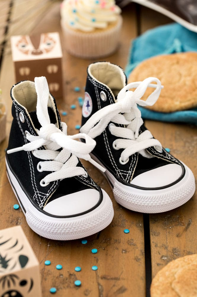baby shoes on wood surface