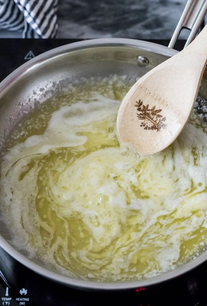 How to make brown butter: swirling the melted butter over medium heat