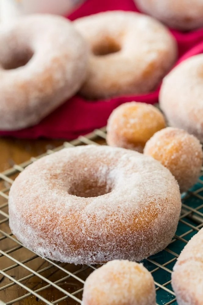 Homemade donuts that have been coated with granulated sugar