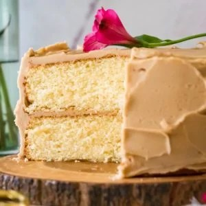 caramel cake with slice taken out