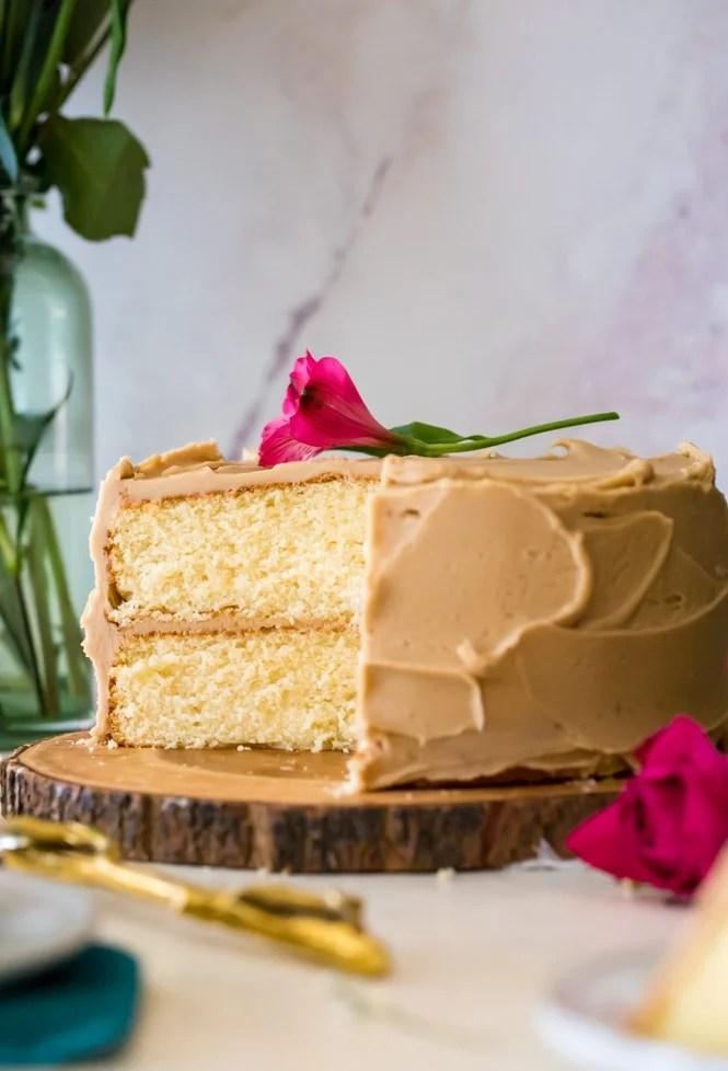 caramel cake on wooden serving platter