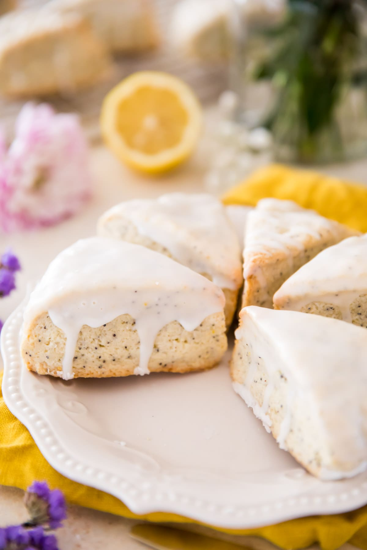 lemon poppy seed scones on white plate with yellow cloth