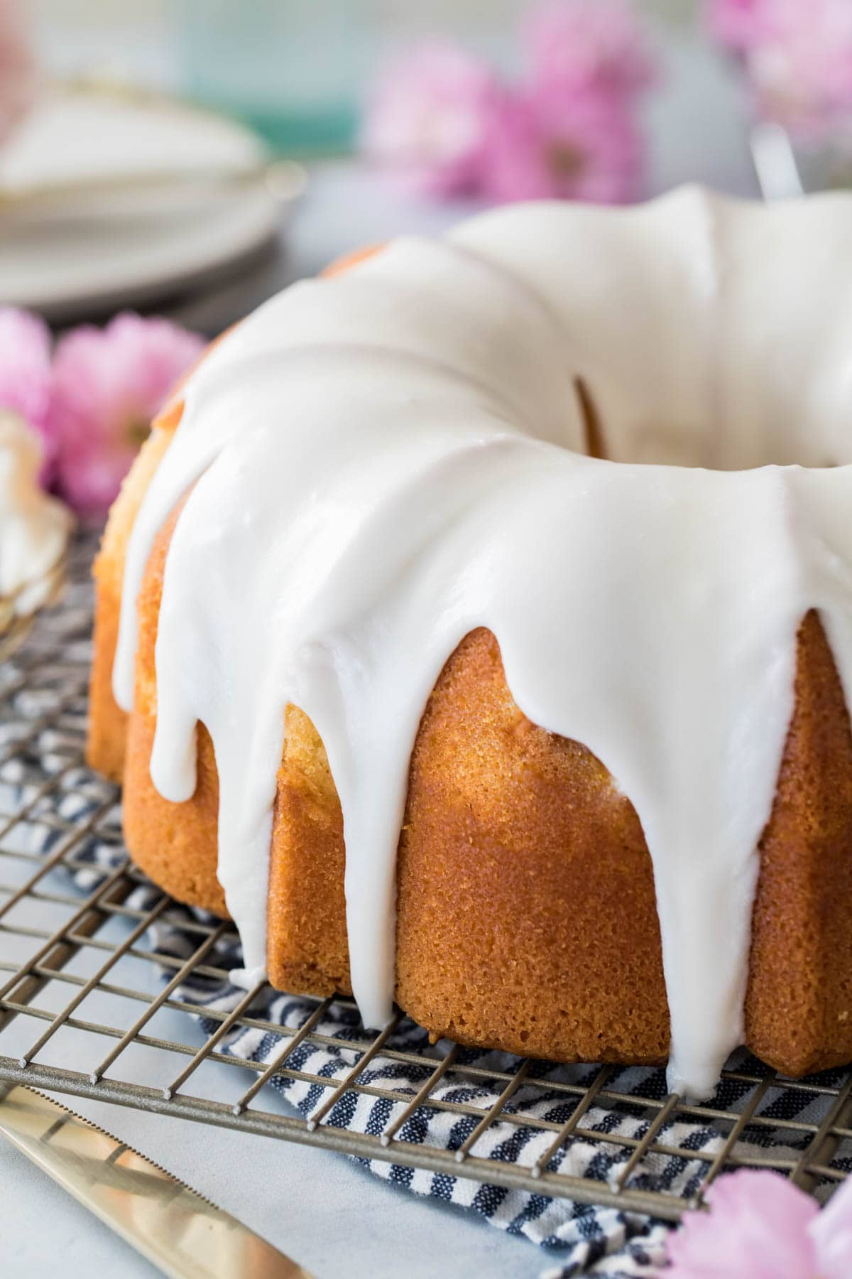 glazed bundt cake on cooling rack