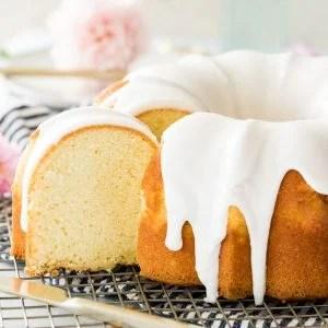 sliced vanilla bundt cake on cooling rack
