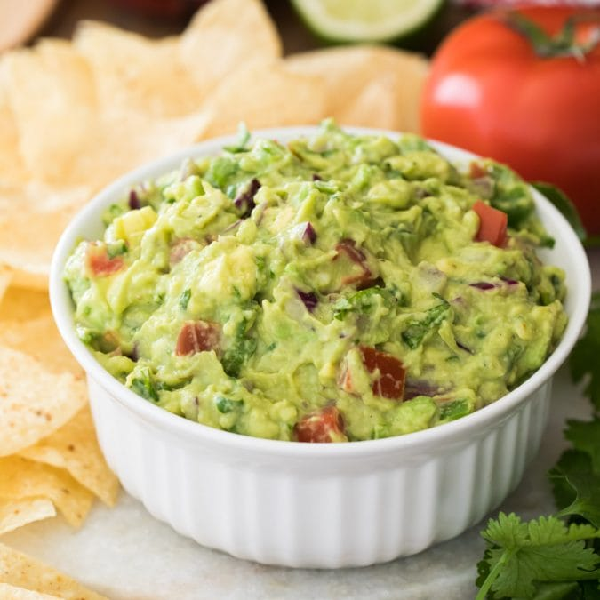 guacamole in white bowl