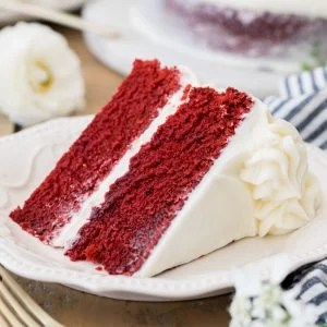 slice of red cake on white plate