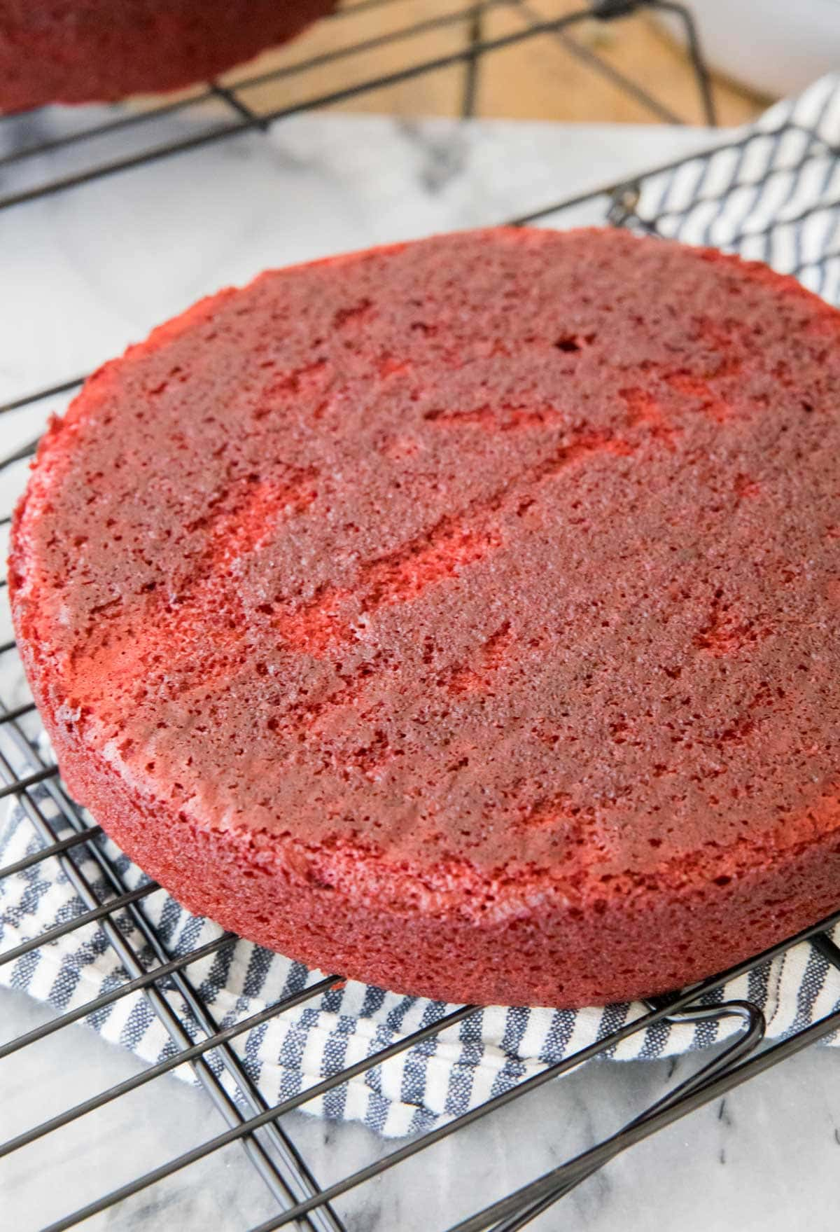 red velvet cake cooling on cooling rack