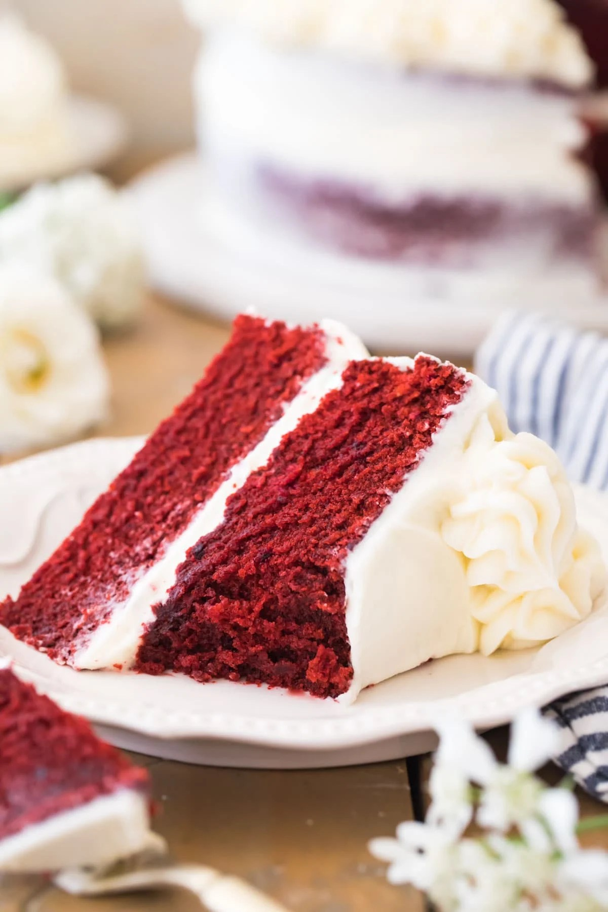 slice of red cake with bite missing