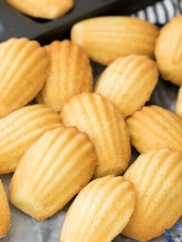 Madeleines arranged on marble board