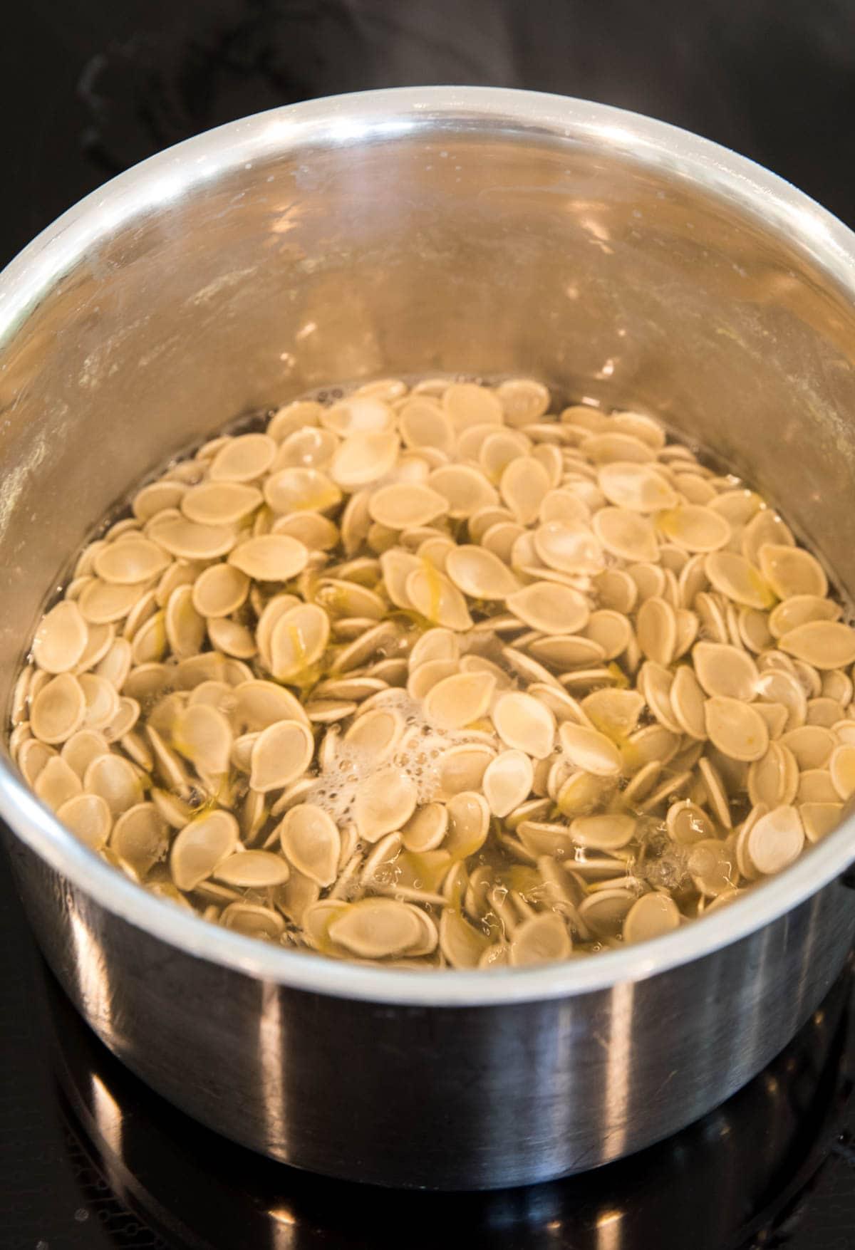 boiling pumpkin seeds