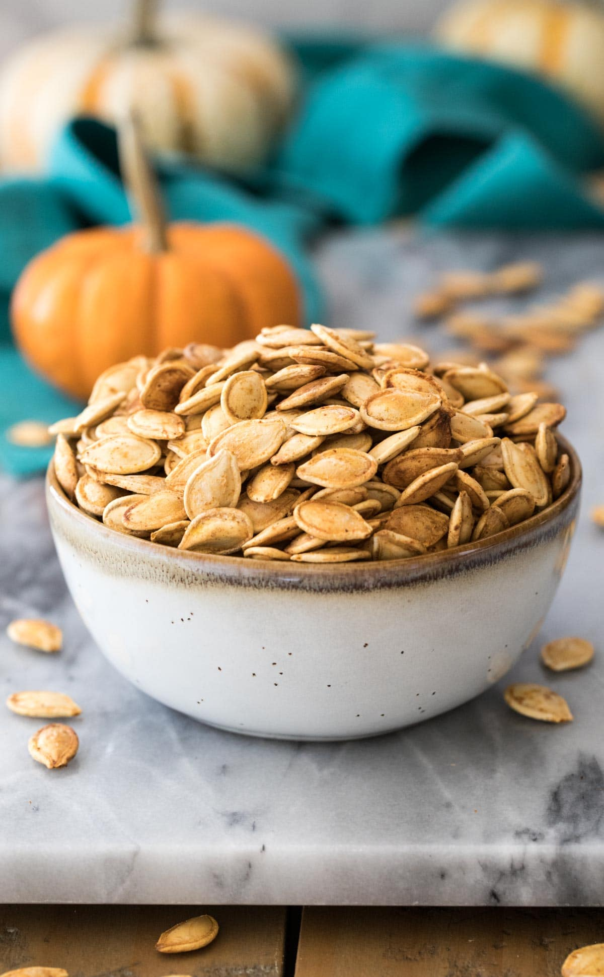 pumpkin seeds in small gray bowl