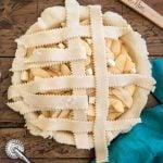 weaving a second vertical strip of pie dough