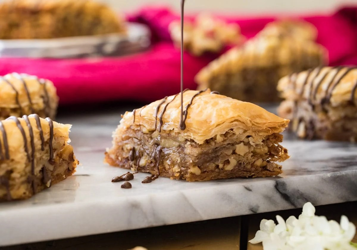 drizzling chocolate on baklava